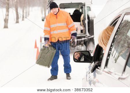 Woman broken car man gas can snow assistance winter mechanic