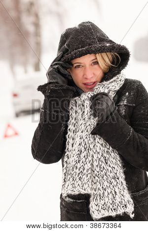 Woman with car breakdown snow accident road winter broken upset