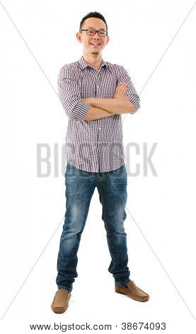 Full body casual Asian male standing over white background