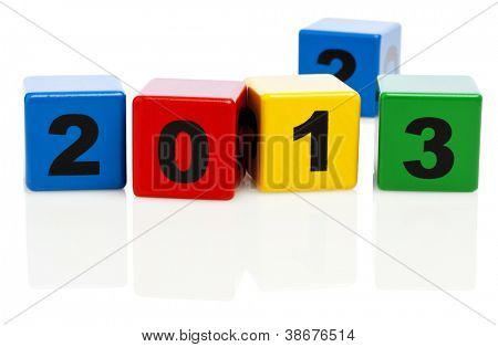 Alphabet building blocks showing the year 2013, block with number 2 in background