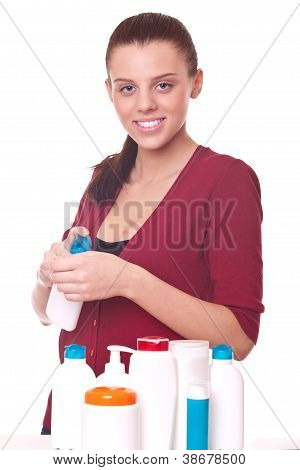 Young Woman Squeezing The Cream On His Hand