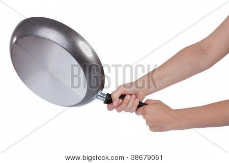 Woman beating with a frying pan isolated on white