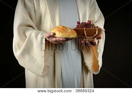 Jesus hands holding bread and grapes, symbols of communion