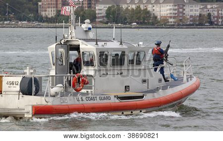NEW YORK-OCT 6: Armed Coast Guard patrols the Hudson River near the USS Michael Murphy (DDG 112) docked at Pier 88 in New York on October 6, 2012. A formal ceremony commissioned the ship into service.