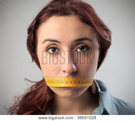 Girl with a tape over her mouth