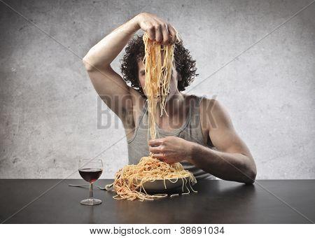 Man dividing spaghetti
