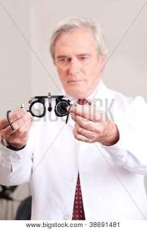 Optometrist holding a eye test glasses.