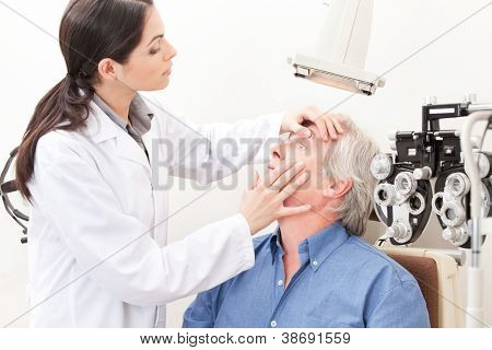 Optometrist taking an eyesight test examination.