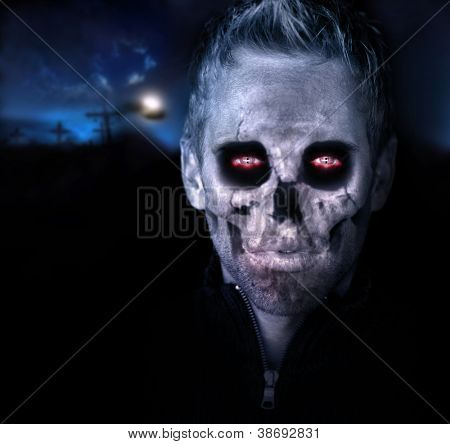 Scary portrait of a zombie in graveyard setting