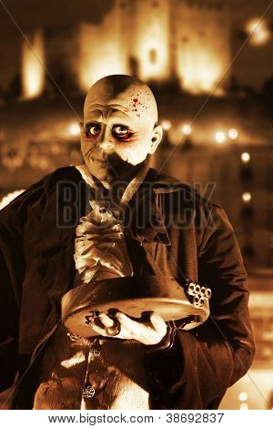 Halloween image of a ghoulish figure and a spooky night background in sepia tones