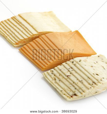 Assortment Of Cheese Slices On White Background