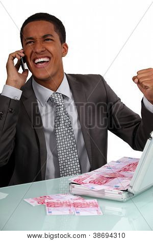 Ecstatic businessman with a briefcase full of money