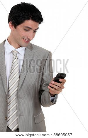 Businessman excited by text message in mobile