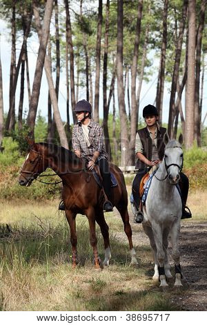 man and woman riding horses