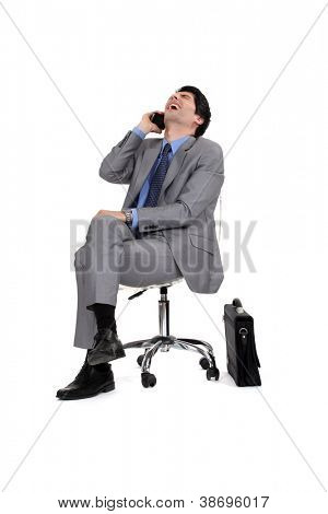 Businessman sitting and laughing