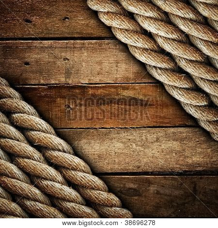 old wood plank with rope