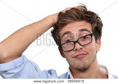 young man wearing glasses making a funny face