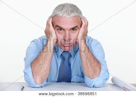 mature businessman visibly bored