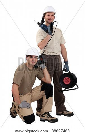 Tradesmen posing with their tools