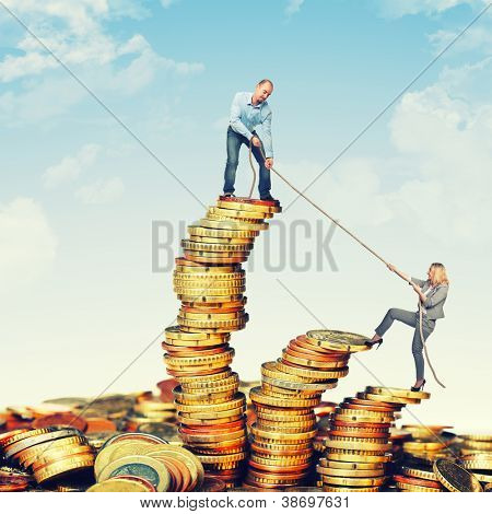business team on euro coin piles