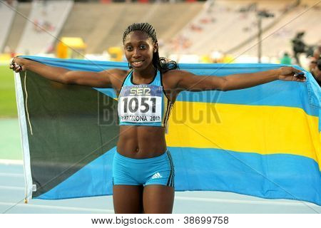 BARCELONA - JULY, 13: Anthonique Strachan of Bahamas celebrates gold of 200m event the 20th World Junior Athletics Championships at the Olympic Stadium on July 13, 2012 in Barcelona, Spain