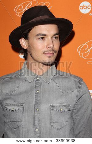 """LOS ANGELES - OCT 16:  Tyler Blackburn arrives at  """"Pretty Little Liars"""" Special Halloween Episode Screening at Hollywood Forever Cemetery on October 16, 2012 in Los Angeles, CA"""