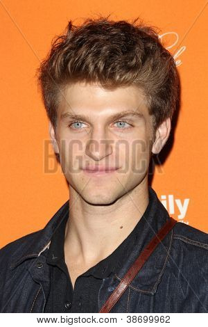 "LOS ANGELES - OCT 16:  Keegan Allen arrives at  ""Pretty Little Liars"" Special Halloween Episode Screening at Hollywood Forever Cemetery on October 16, 2012 in Los Angeles, CA"