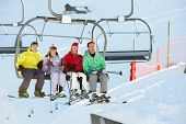 stock photo of lifting-off  - Teenage Family Getting Off chair Lift On Ski Holiday In Mountains - JPG