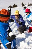 pic of snowball-fight  - Family Having Snowball Fight On Ski Holiday In Mountains - JPG