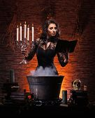 image of witchcraft  - Young sexy witch making the witchcraft in the dungeon - JPG