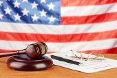 stock photo of divorce-papers  - Divorce decree and wooden gavel on american flag background - JPG