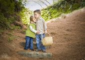 pic of brother sister  - Adorable Brother and Sister Children with Basket Hugging Outside - JPG