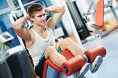 pic of abdominal muscle  - bodybuilder man at abdominal crunch muscles exercises during training in fitness gym - JPG