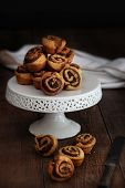 Delicious cinnamon pinwheel rolls on white cake stand
