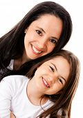 Happy mother and daughter smiling - isolated over a white background