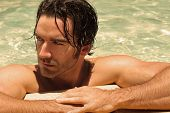 stock photo of good-looker  - Detailed portrait of a beautiful male model in swimming pool - JPG