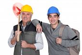 image of school-leaver  - Experienced tradesman posing with his new apprentice - JPG