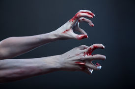 picture of pale skin  - Zombie stretching bloody hands - JPG