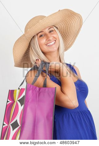 Portrait Of A Young Woman Smiling With Her Shopping Bag