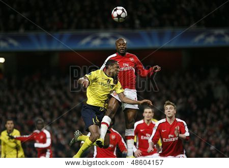 LONDON, ENGLAND. 31/03/2010. Barcelona player Seydou Keita and Arsenal player William Gallas during the  UEFA Champions League quarter-final between Arsenal and Barcelona at the Emirates Stadium