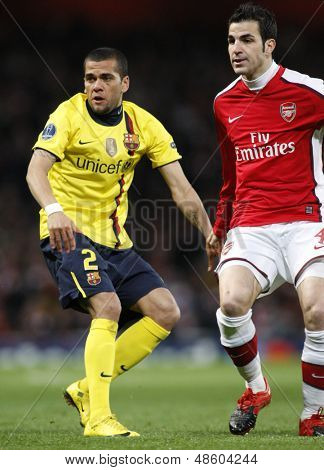 LONDON, ENGLAND. 31/03/2010. Barcelona's Dani Alves and Arsenal player Cesc Fabregas in action during the  UEFA Champions League quarter-final between Arsenal and Barcelona at the Emirates Stadium
