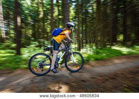 Girl biking - motion blur