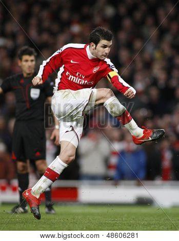LONDON, ENGLAND. 31/03/2010. Arsenal player Cesc Fabregas (captain) taking and scoring a penalty  during the  UEFA Champions League quarter-final between Arsenal and Barcelona at the Emirates Stadium