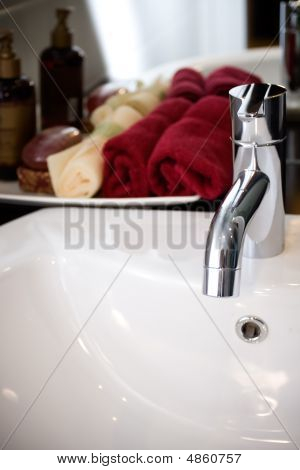 Clean And Modern Washbasin With Bathing Supplies