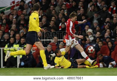 LONDON, ENGLAND. 31/03/2010. Barcelona's Dani Alves and Arsenal player Nicklas Bendtner in action during the  UEFA Champions League quarter-final between Arsenal and Barcelona at the Emirates Stadium