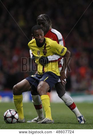 LONDON, ENGLAND. 31/03/2010. Barcelona's Seydou Keita and Arsenal player Bacary Sagna in action during the  UEFA Champions League quarter-final between Arsenal and Barcelona at the Emirates Stadium