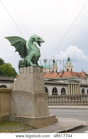 Dragon Sculpture On Dragon Bridge View  Cathedral Saint Nicholas Old Town On Ljubljanica River Ljubl