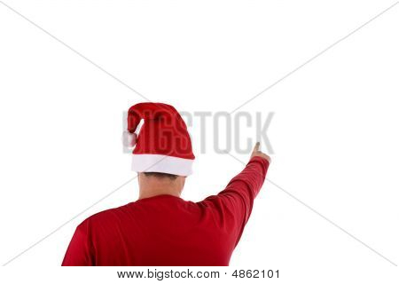 Man Wearing A Red Santa Hat Pointing At Something Over White