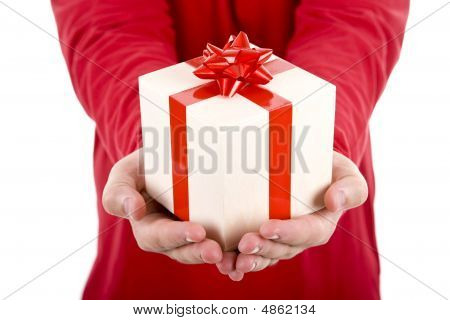 Man Wearing Red Shirt Holding A Christmas Gift Box