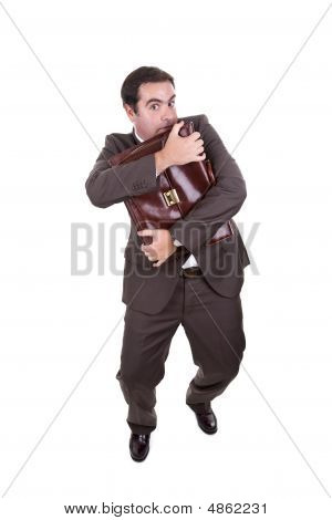Businessman Latching Onto Briefcase